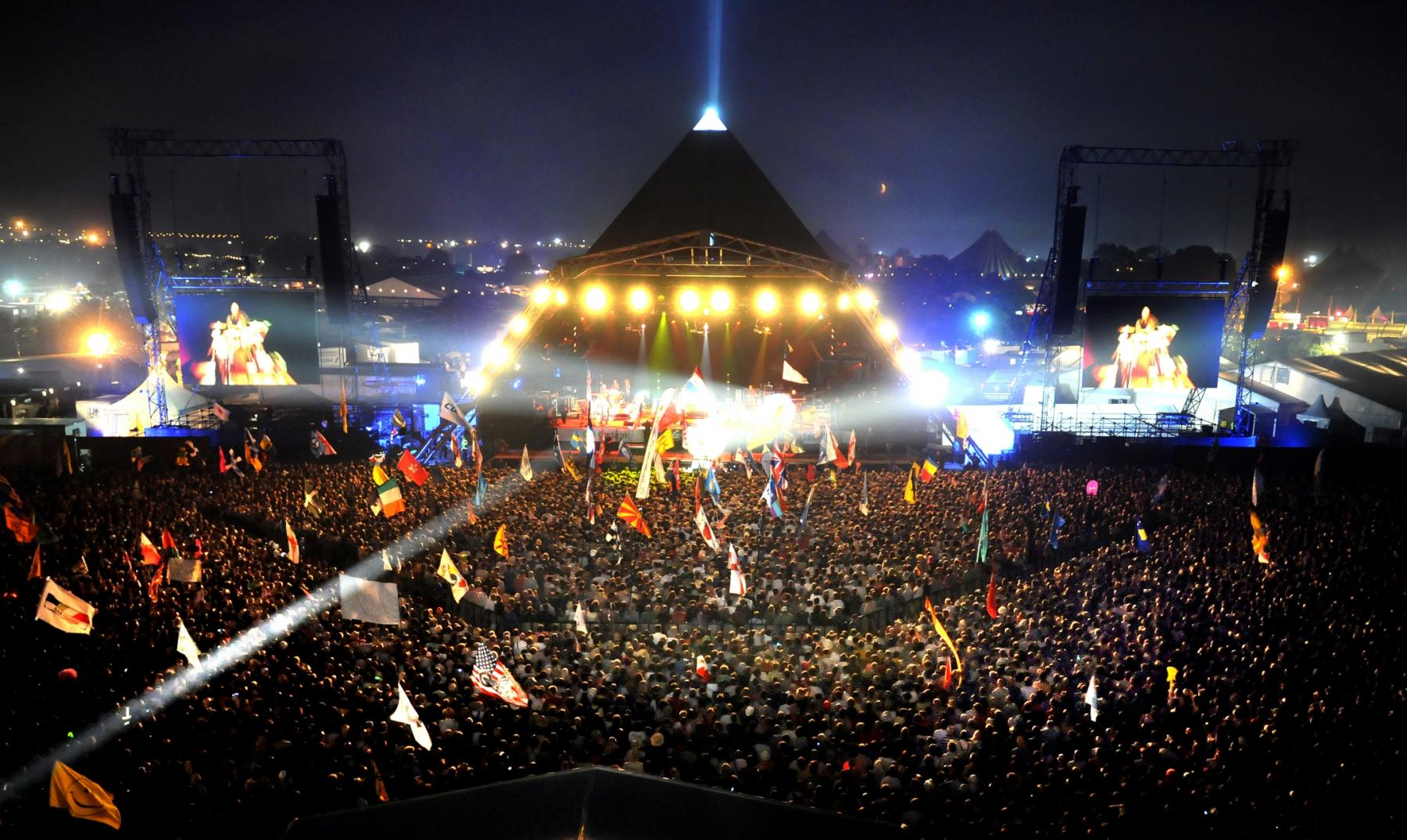 Crowd at Glastonbury Festival Pyramid Stage at night
